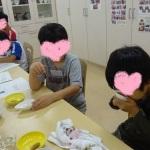 子どもの官能検査(こどもの顔をハートで隠したもの)